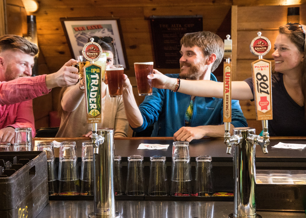 Friends clink beers in the Sitzmark bar.