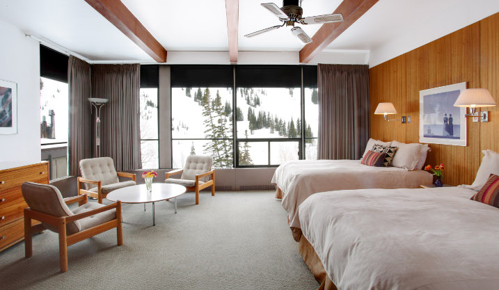 Slope facing room at Alta Lodge with three beds and sitting area