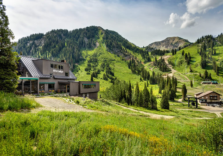 The Alta Lodge nestled in green mountains during summer