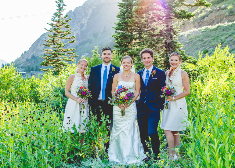 Bride with bridesmaids and groomsman in the mountains