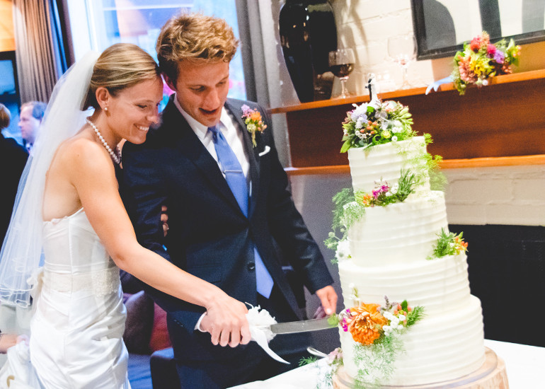 Bride and groom cutting the cake during wedding at the Alta Lodge