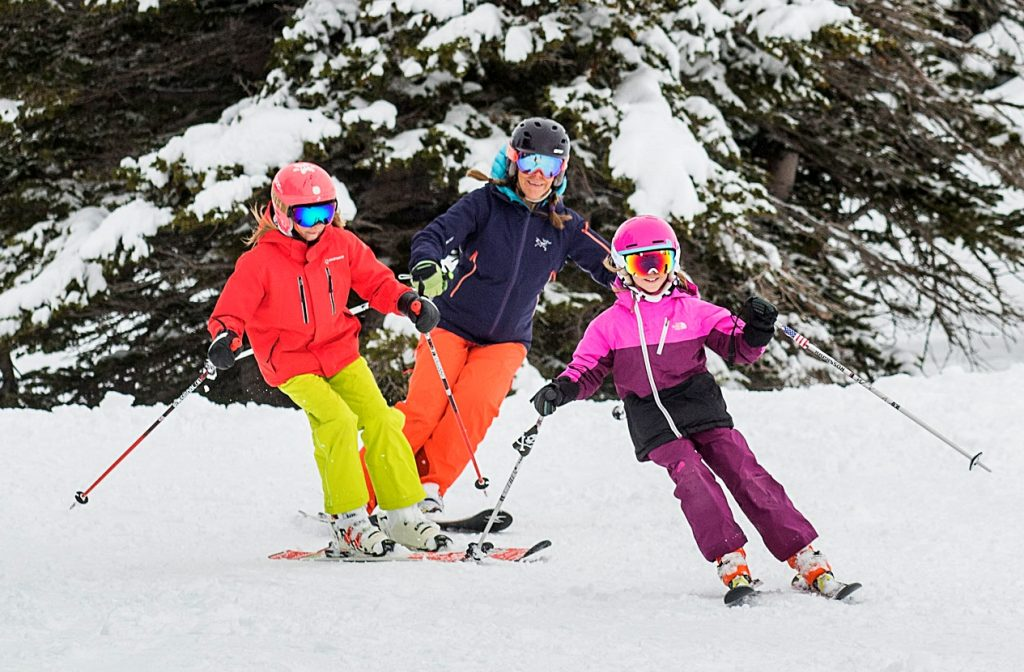 Family girls skiing